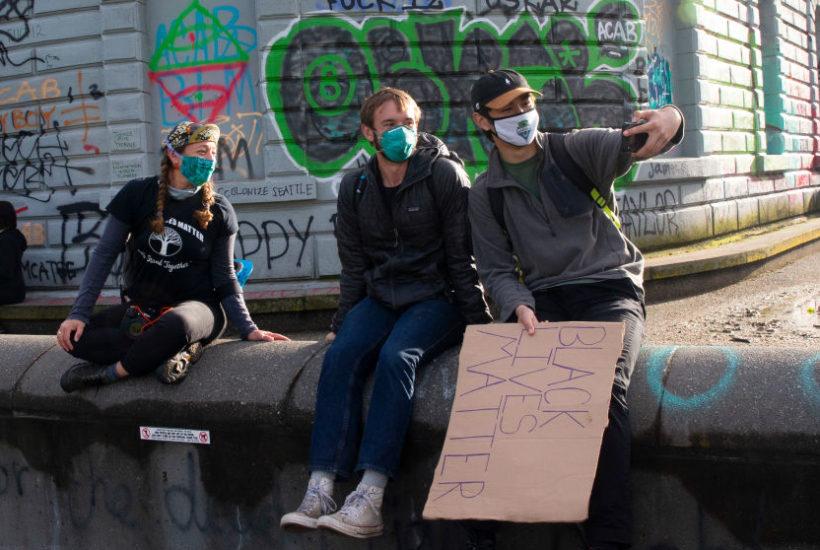 revolt Friends take a selfie in the the Capitol Hill Autonomous Zone (CHAZ) in Seattle, Washington
